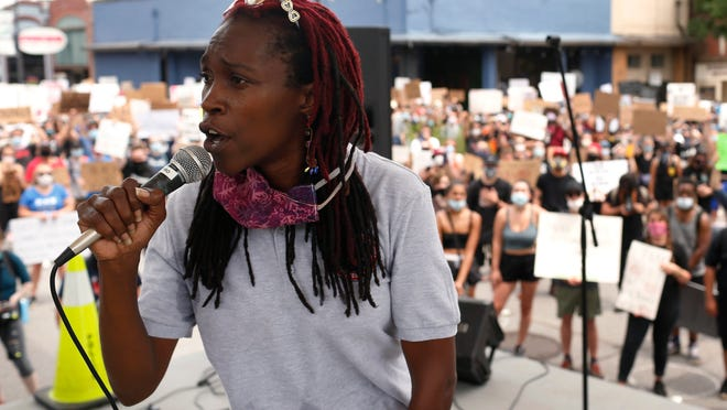 Mokah Jasmine Johnson of the Athens Anti-Discrimination Movement speaks to a crowd during a racial justice rally last June. Johnson started the Freedom Fund in 2018, which helps bail those lacking financial resources out of jail.