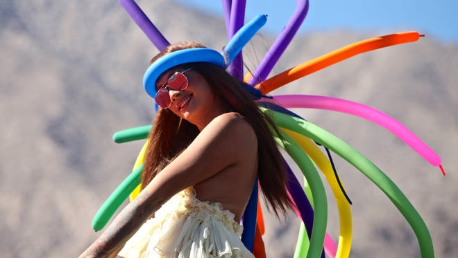 Thousands marched down North Palm Canyon Drive for the annual Palm Springs Pride parade on Sunday, Nov. 8, 2015.