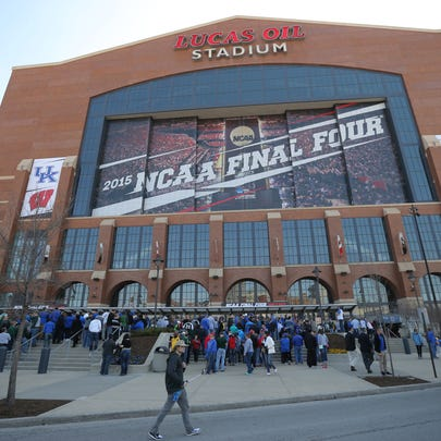 Fans mingle outside Lucas Oil Stadium before Michigan