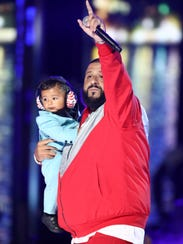 "DJ Khaled performs ""I'm The One"" while holding his"