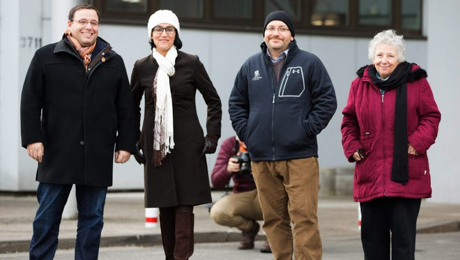 Freed US journalist Jason Rezaian, second from right, and his wife Yeganeh Salehi (second left), are flanked by his brother Ali Rezaian, left, and their mother Mary Rezaian as they pose in front of the US military hospital in Landstuhl, Germany, January 20, 2016 following Rezaian's release from a Tehran Iran prison.