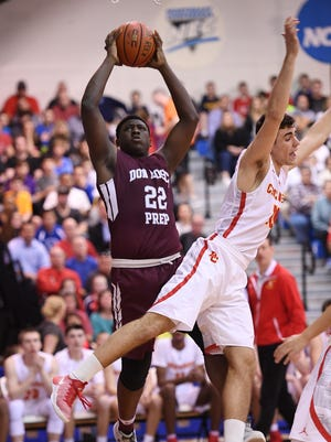 Don Bosco's Marcellus Earlington (22), left, grabs a rebound in the first quarter against Bergen Catholic's Gabe Stefanini (10). Don Bosco went on to win its ninth title in the 61st Bergen County Jamboree boys basketball final at Fairleigh Dickinson's Rothman Center in Hackensack on Friday, Feb. 24, 2017.