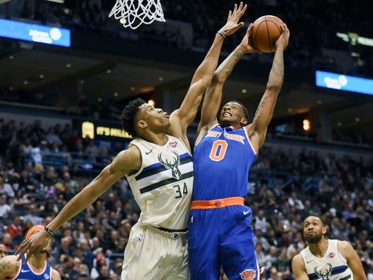 New York Knicks forward Troy Williams (0) takes a shot against Milwaukee Bucks forward Giannis Antetokounmpo (34) in the first quarter at BMO Harris Bradley Center.