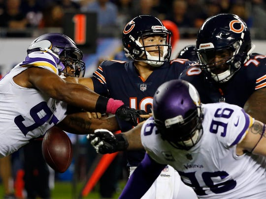 Minnesota Vikings defensive end Everson Griffen (97) strips the ball from Chicago Bears quarterback Mitchell Trubisky (10) during the first half of an NFL football game, Monday, Oct. 9, 2017, in Chicago.