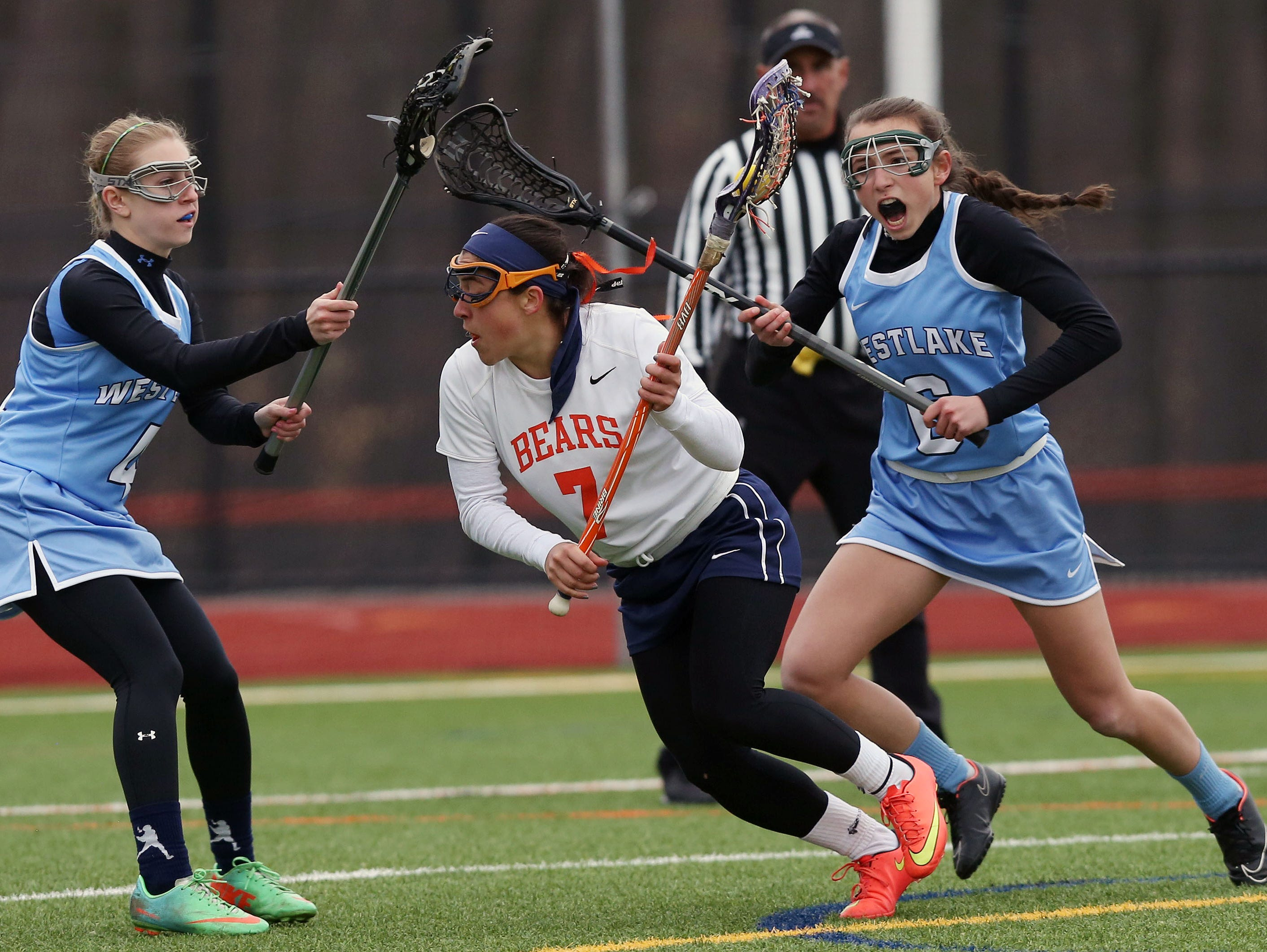 Briarcliff's Lexi Grasso (7) gets between Westlake's Ariella Ruggiero (4) and Allie Falkenberg (6) during first half action in the championship game of the Mt. Pleasant Cup girls lacrosse tournament at Briarcliff High School March 24, 2016. Briarcliff won the game 15-9.