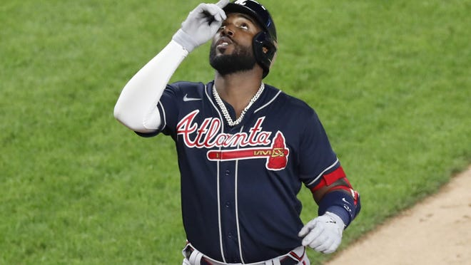 Atlanta Braves Marcell Ozuna reacts crossing the plate after hitting a three-run, home run during a baseball game against the New York Yankees, Tuesday, Aug. 11, 2020, in New York.