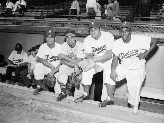 Shown here are, left to right, Roy Campanella, Larry Doby of Paterson, Don Newcombe and Jackie Robinson at the 16th annual All-Star Game at Ebbetts Field in Brooklyn on July 12, 1949.