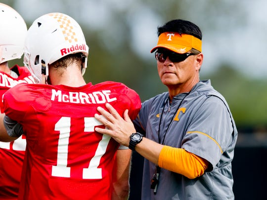 Quarterbacks coach Mike Canales pats Tennessee quarterback Will McBride (17) on the back during Tennessee fall football practice at Anderson Training Facility in Knoxville, Tennessee on Tuesday, October 10, 2017.