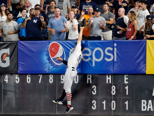 New York Yankees right fielder Aaron Judge (99) is unable to make a catch on a two-run home run by Atlanta Braves left fielder Ronald Acuna Jr.
