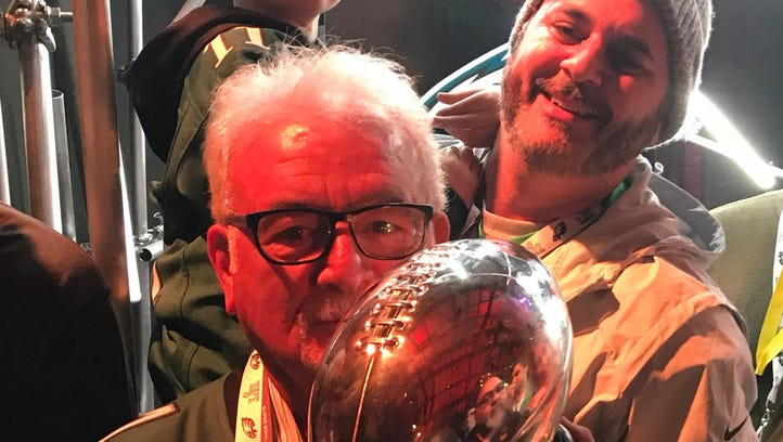 Three generations of Delaware family kiss Lombardi Trophy
