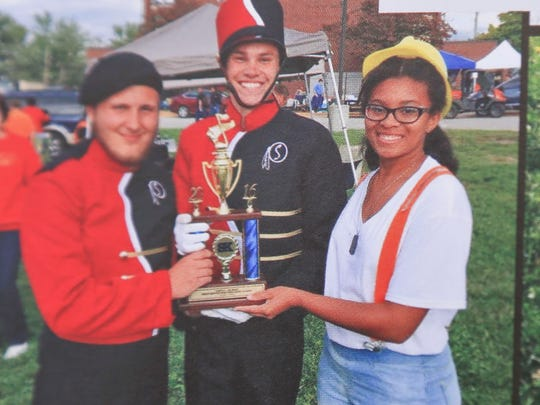 Yearbook photo of Seneca High senior Lunden Pope, 17, at right, who died from injuries after being struck by a car while she crossed Poplar Level Road against a green light late Thursday afternoon. She was set to graduate next Thursday.