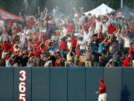 Jacksonville State outfielder Griff Gordon  takes a slow walk past the outfield wall as fans celebrate a sixth inning home run by Mississippi's Sikes Orvis during an NCAA college baseball regional tournament game in Oxford, Miss., Saturday, May 31, 2014. (AP Photo/Rogelio V. Solis)