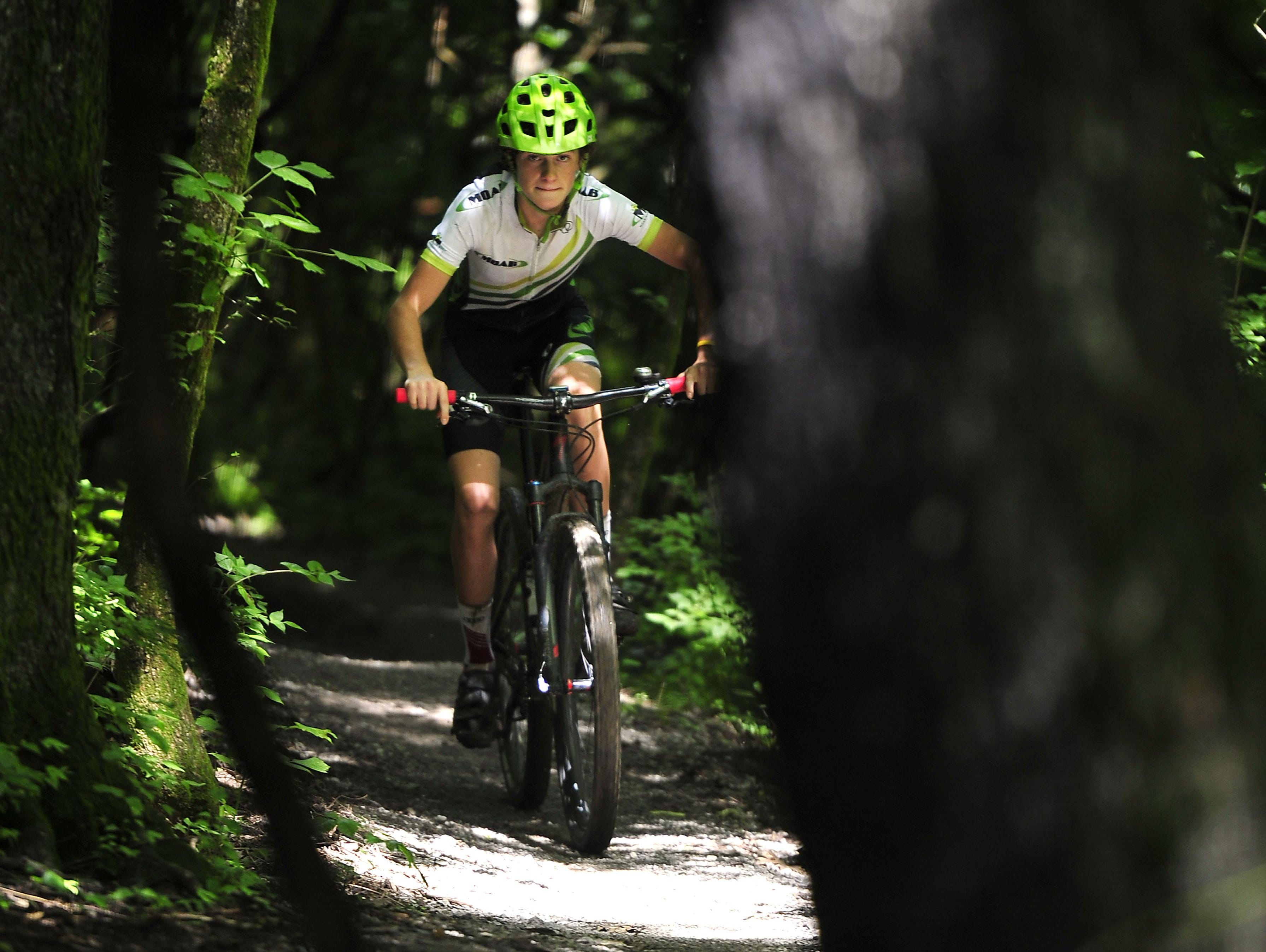 "Simon Lewis, 16, will compete in a national mountain bike race this week. ""It's all about motivation. You gotta really want it. No one's really pushing me for it,"" he says."