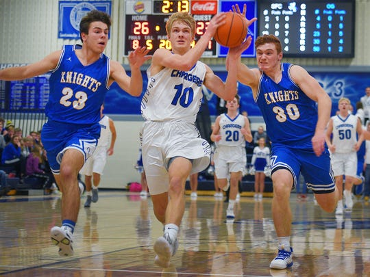 O'Gorman's Zach Norton (23),  SF Christian's Mitchell Oostra (10) and O'Gorman's Canyon Bauer (30) race towards the other side of the court during the game Tuesday, Jan. 2, at O'Gorman.
