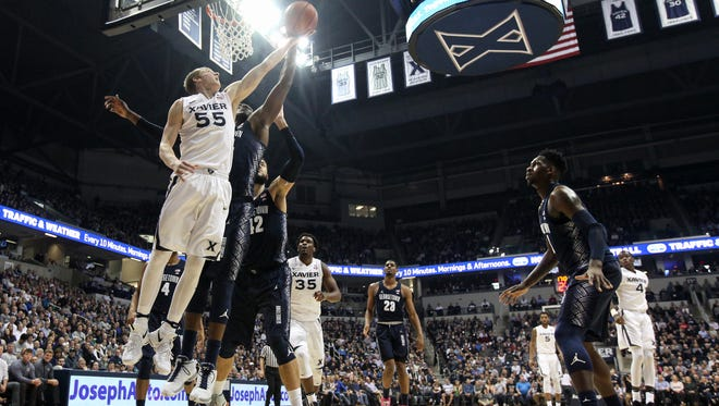 Xavier Musketeers guard J.P. Macura (55) goes up for a shot in the first half during the college basketball game between the Georgetown Hoyas and Xavier Musketeers, Sunday, Jan. 22, 2017, at Cintas Center in Cincinnati.