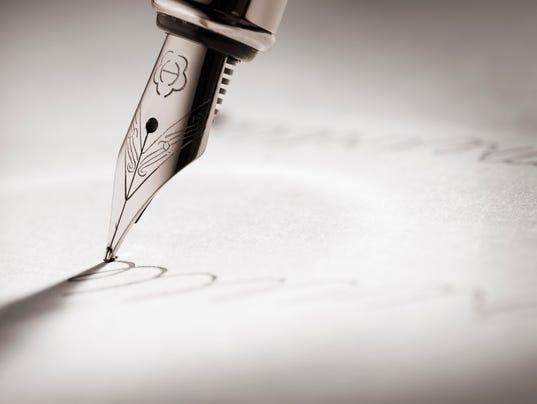 Fountain pen writing a signature
