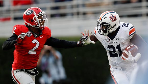 Georgia defensive back Maurice Smith (2), here trying