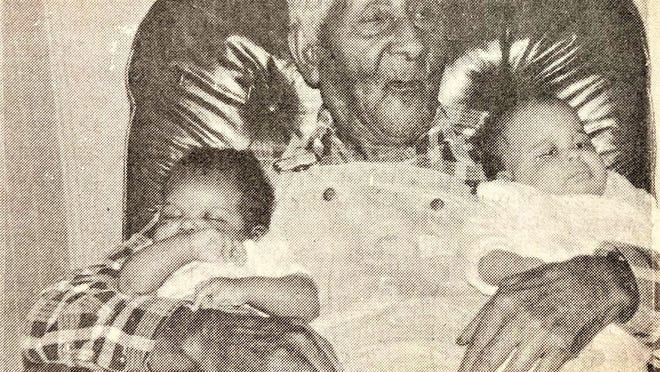 Willie Hawes, of Appling, celebrates his 118th birthday with two great-great granddaughters in 1990.