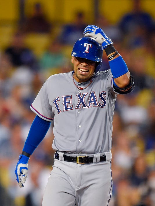Texas Rangers' Robinson Chirinos reacts after being hit by a pitch during the fifth inning of a baseball game against the Los Angeles Dodgers, Thursday, June 18, 2015, in Los Angeles. (AP Photo/Mark J. Terrill)