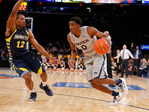 Xavier Musketeers guard Semaj Christon (0) drives to the basket against Marquette Golden Eagles guard Derrick Wilson (12).