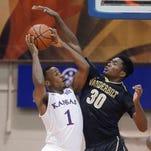 Kansas guard Wayne Selden Jr. goes to the basket over Vanderbilt forward Jeff Roberson during the first half.