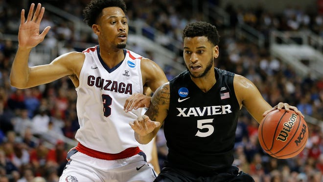 Xavier Musketeers guard Trevon Bluiett (5) drives to the basket as Gonzaga Bulldogs forward Johnathan Williams (3) defends in the first half.