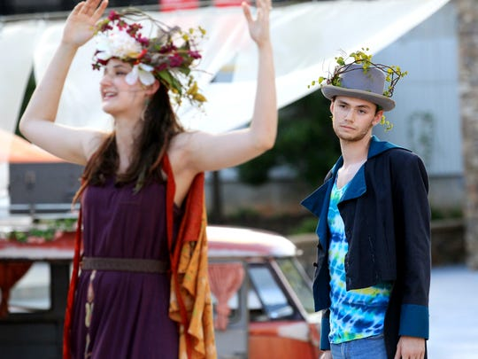 Drew Whitley and Jenni Baldwin, playing the roles of Oberon and Titania, perform in a production of Shakespeare's A Midsummer Night's Dream in Carolina Wren Park in the first year of the Theatre Festival.