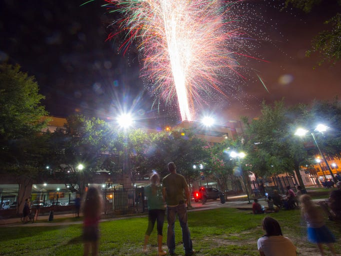 Spectators watch the Independance Day fireworks display