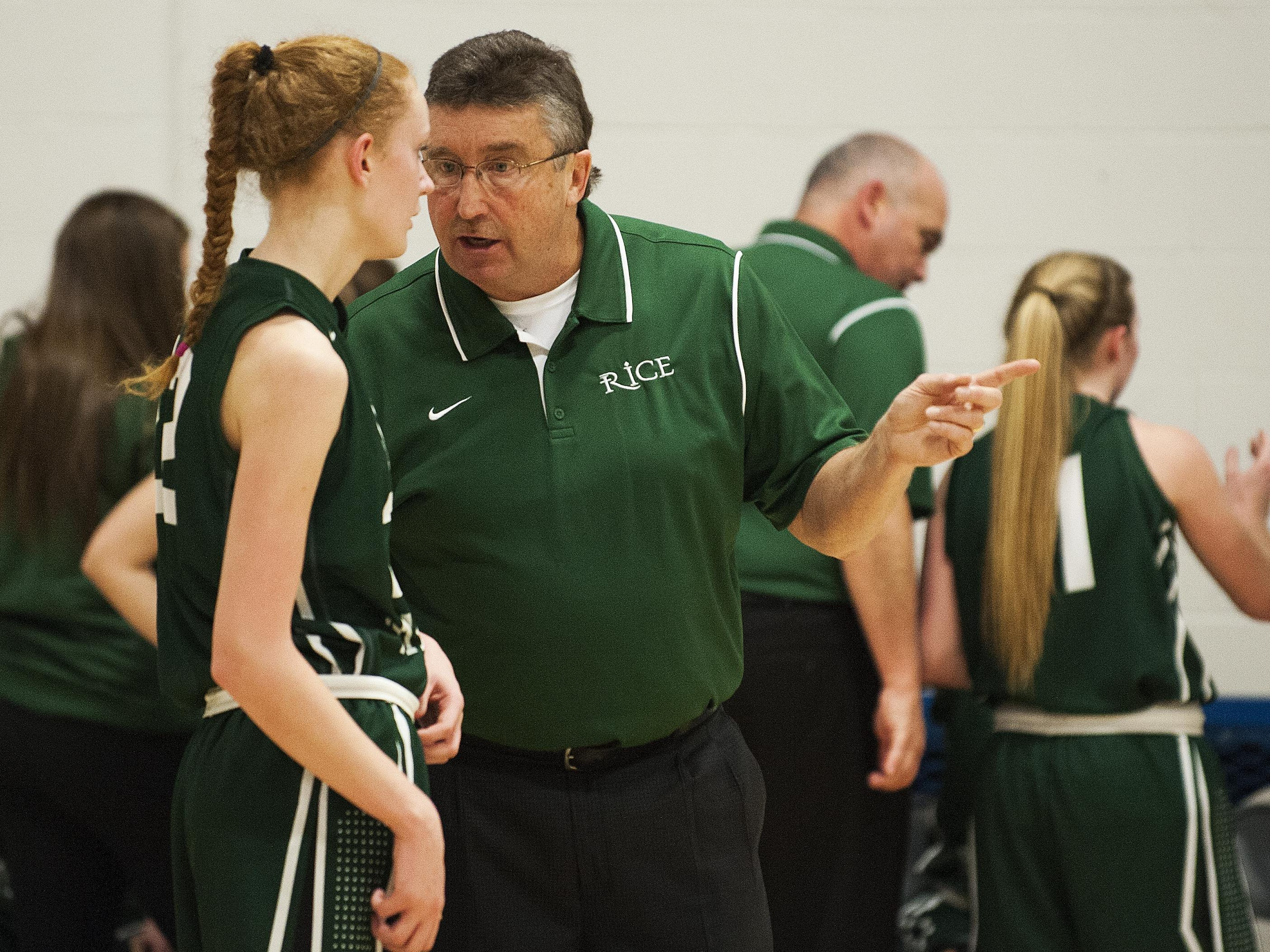 Rice head coach Tim Rice talks to Rice forward Lizzy Lyman (22) during the girls basketball game between the Rice Green knights and the Mount Mansfield Cougars at MMU High School on Friday night December 4, 2015 in Jericho.