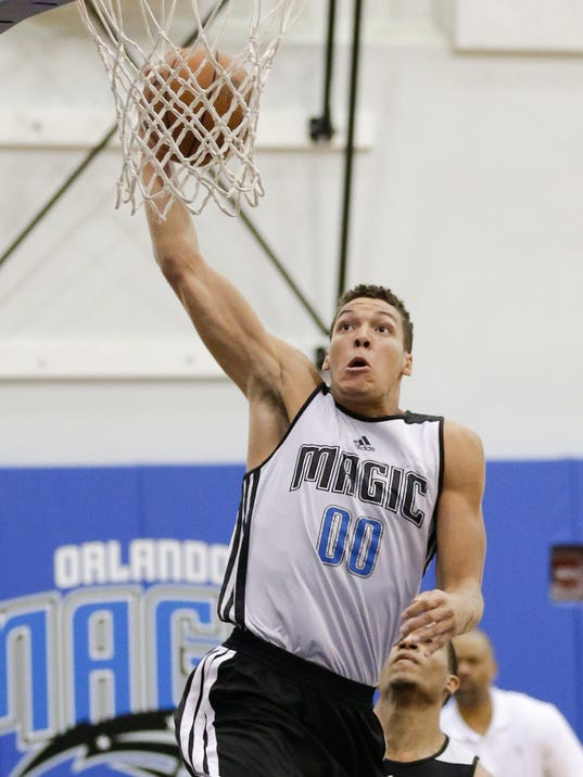 Orlando Magic's Aaron Gordon makes a shot against the Houston Rockets during an NBA summer league basketball game in Orlando, Fla., Monday, July 7, 2014. (AP Photo/John Raoux)