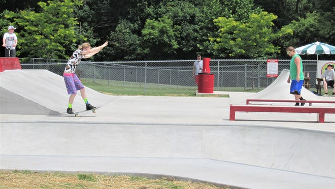 Brad Loomis of Benton displays his balance as he rides a ramp at the new skate park in Millersburg. Loomis said he is glad to see a cement park so close to his home.