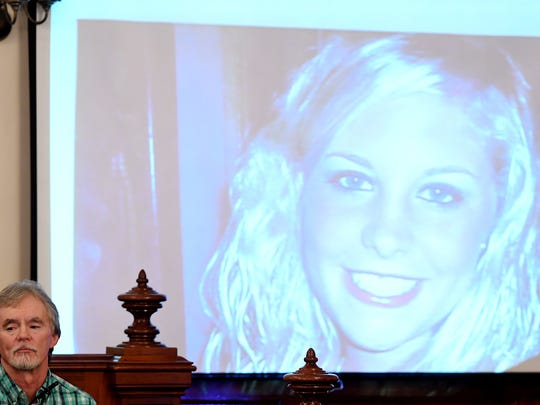 A photo of Holly Bobo is presented on the overhead projector as her father, Dana Bobo, testifies in the trial against Zach Adams.
