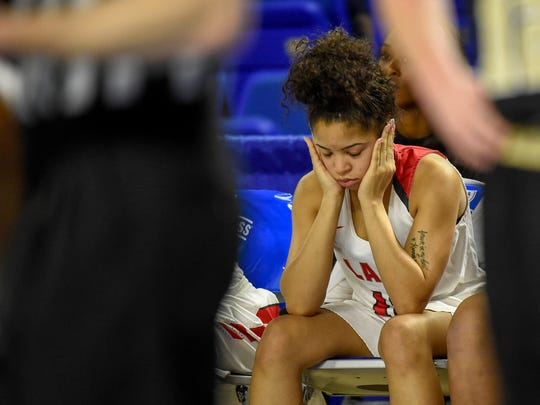 East Nashville High School Special Osborne (12) reacts as  the clock runs down and the Upperman High School defeats them in the TSSAA Basketball Girls State Championship at the Murphy Center in Murfreesboro, Tenn., Thursday, March 8, 2018.