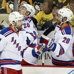New York Rangers left wing Rick Nash (61) is congratulated by center Dominic Moore (28) after Nash scored a goal against the Pittsburgh Penguins during the first period in Game 5 of the first round of the 2016 Stanley Cup playoffs.