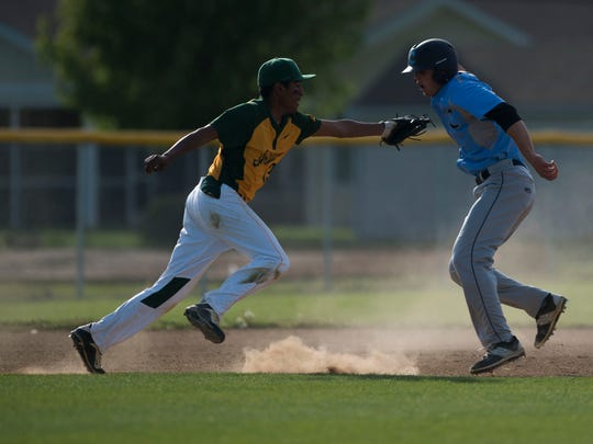 Cape's Kai Vitella, right, is caught in a rundown in a game against Indian River April 29 in Lewes.
