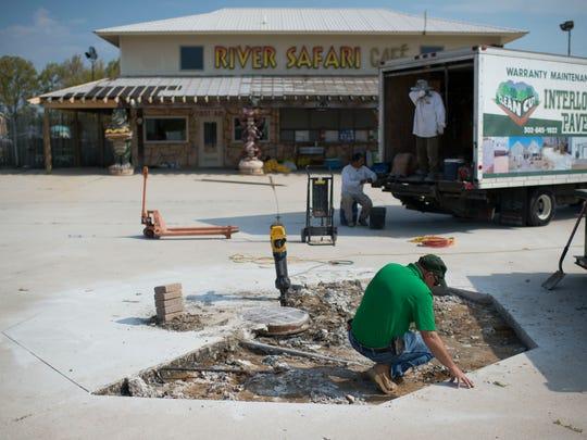 Maintenance supervisor Jim Davis looks over paving work Wednesday, May 6 at Jungle Jim's in Rehoboth Beach.