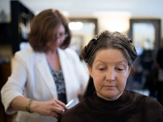 """Enza's owner and stylist Zina Gallo Brechbill works on Lisa Ludwig's hair at her organic, eco-friendly salon. The name """"Enza"""" is short for her Sicilian birthname, Vicenza."""