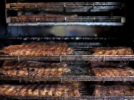 Racks of ribs slowly cook on site at Uncle Pig's Barbecue Pit Tuesday in Gibbstown.