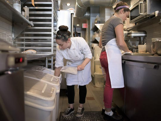 Head baker Jessica Stern (left) preps raw ingredients for a batch of cranberry walnut scones as she works inside the Bakeshop on Twentieth in Philadelphia.