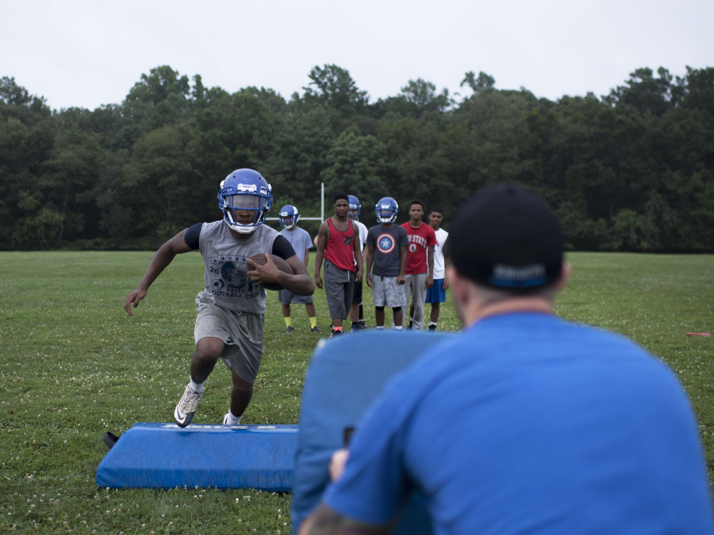 Sterling senior Larry Bey runs through drills Tuesday, August 11 in Somerdale.
