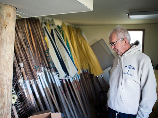 Ron Steen of Steen's Beach Service looks through umbrellas, some dating back to the 1970's in his garage Friday, Nov. 14 in Bethany Beach. Steen was recently granted a two-year extension.