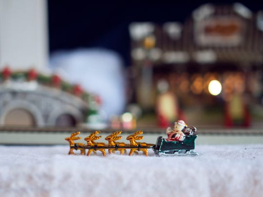 A miniature reindeer and sleigh inside the Edwards'