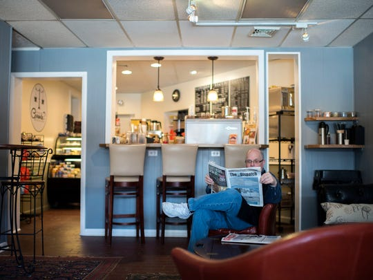 On What Grounds? coffee house owner Dana L. Gottloeb lounges with a newspaper in his shop Friday, Feb. 20 in downtown Berlin.