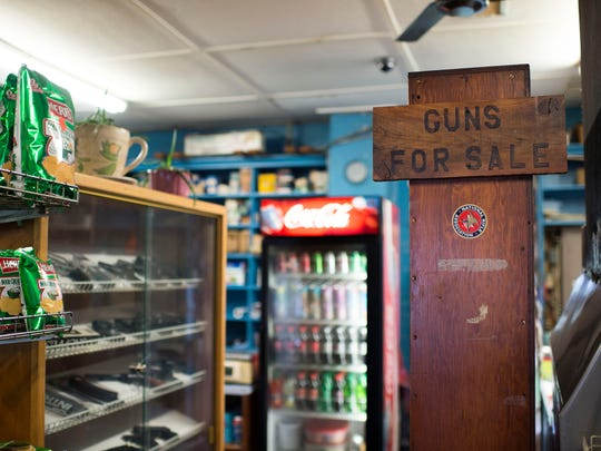 Guns for sale inside Wilson's General Store Tuesday, April 7 in Georgetown.