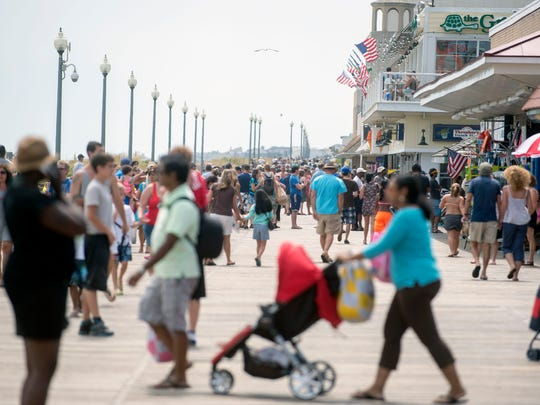 The Rehoboth Beach boardwalk bustles with tourists on Saturday.