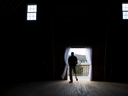 Bryce Lingo enters his barn in Lewes.