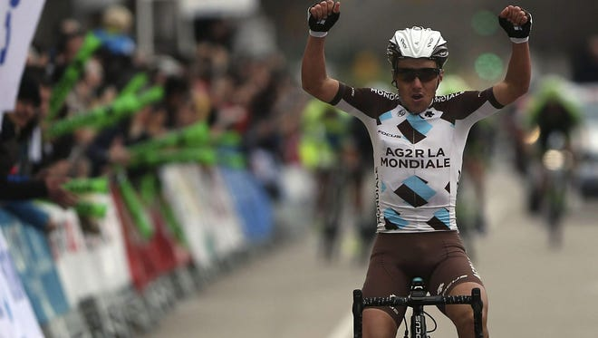 Italian rider Domenico Pozzovivo of AG2R La Mondiale team celebrates his victory in the third stage of the Volta Catalonia cycling race in Girona, Catalonia Spain, on March 25.
