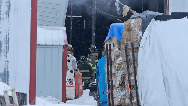 Denmark Fire Department crews respond to a collapsed dairy barn at Cedar Red Dairy 5253 Larsenville Road Saturday, April 14, 2018 in Denmark, Wis. Initial reports were four people and livestock trapped inside.