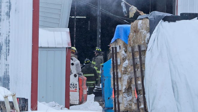 Denmark Fire Department crews respond to a collapsed dairy barn at Cedar Red Dairy, 5253 Larsenville Rd., Saturday, April 14, 2018, in Denmark, Wis. Initial reports indicated there were four people and livestock trapped inside.