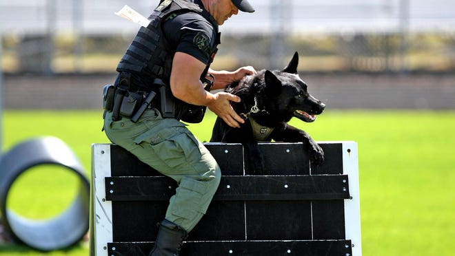 Then-Palm Beach Sheriff's Office canine officer Justin Rigney during a 2012 K-9 demonstration.